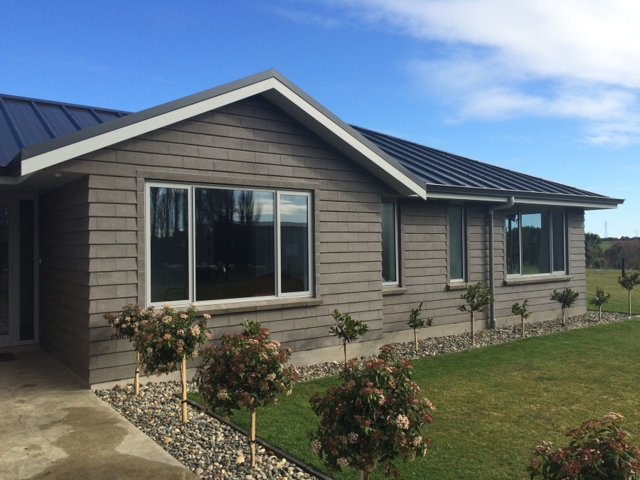 made using gold mine tailings from the clutha river in central otago - External Cladding For Houses